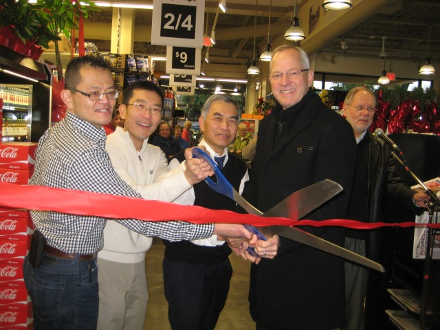 Mayor Jack Froese helps Charlie, Robert & Peter Lee cut the ribbon
