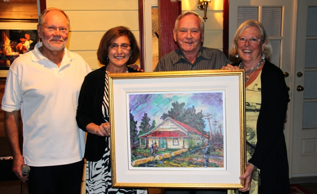 Karl Driese, President of the Willoughby Hall Society accepts Hall artwork