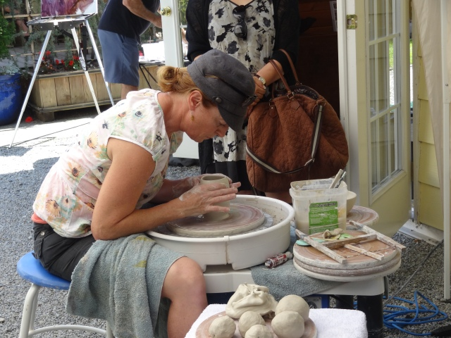 Carolyn MacLaren demonstrating on pottery wheel at Birthplace of B.C. Gallery